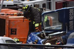 Firefighters responded to the overturned dump truck near the Chain Bridge.