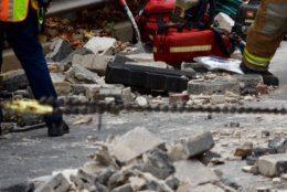 The crash strewed concrete debris across the road.