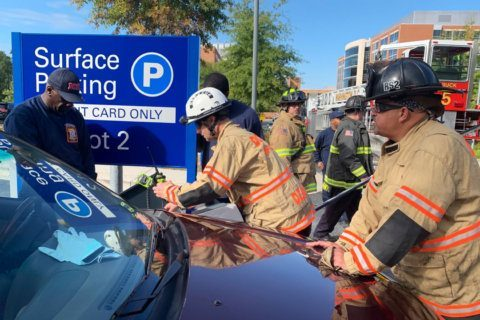DC firefighters rescue woman whose leg was trapped in parking lot mishap