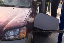 After the woman stepped one foot outside, her car began to move, crashing into the exit machine.