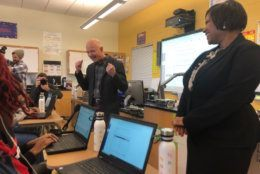 Amazon CEO Jeff Bezos chats with students at Dunbar High. (WTOP/Melissa Howell)
