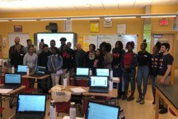 Computer science students at Dunbar High pose with Amazon CEO Jeff Bezos. (WTOP/Melissa Howell)