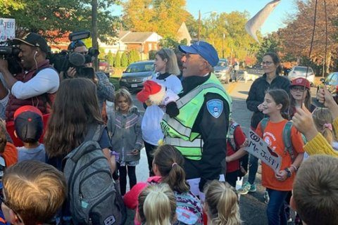 School crossing guard who loves the Washington Nationals surprised with World Series tickets by students