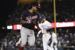 Washington Nationals' Howie Kendrick celebrates after a grand slam against the Los Angeles Dodgers during the 10th inning in Game 5 of a baseball National League Division Series on Wednesday, Oct. 9, 2019, in Los Angeles. (AP Photo/Marcio Jose Sanchez)
