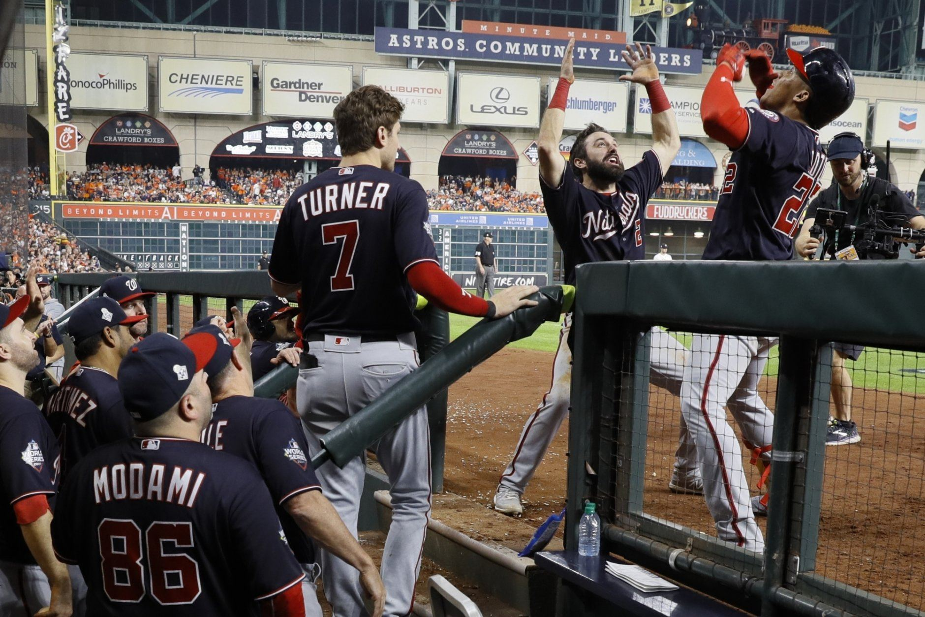 Washington Nationals' Juan Soto is congratulated by Adam Eaton after hitting a home run during the fifth inning of Game 6 of the baseball World Series against the Houston Astros Tuesday, Oct. 29, 2019, in Houston. (AP Photo/Matt Slocum)