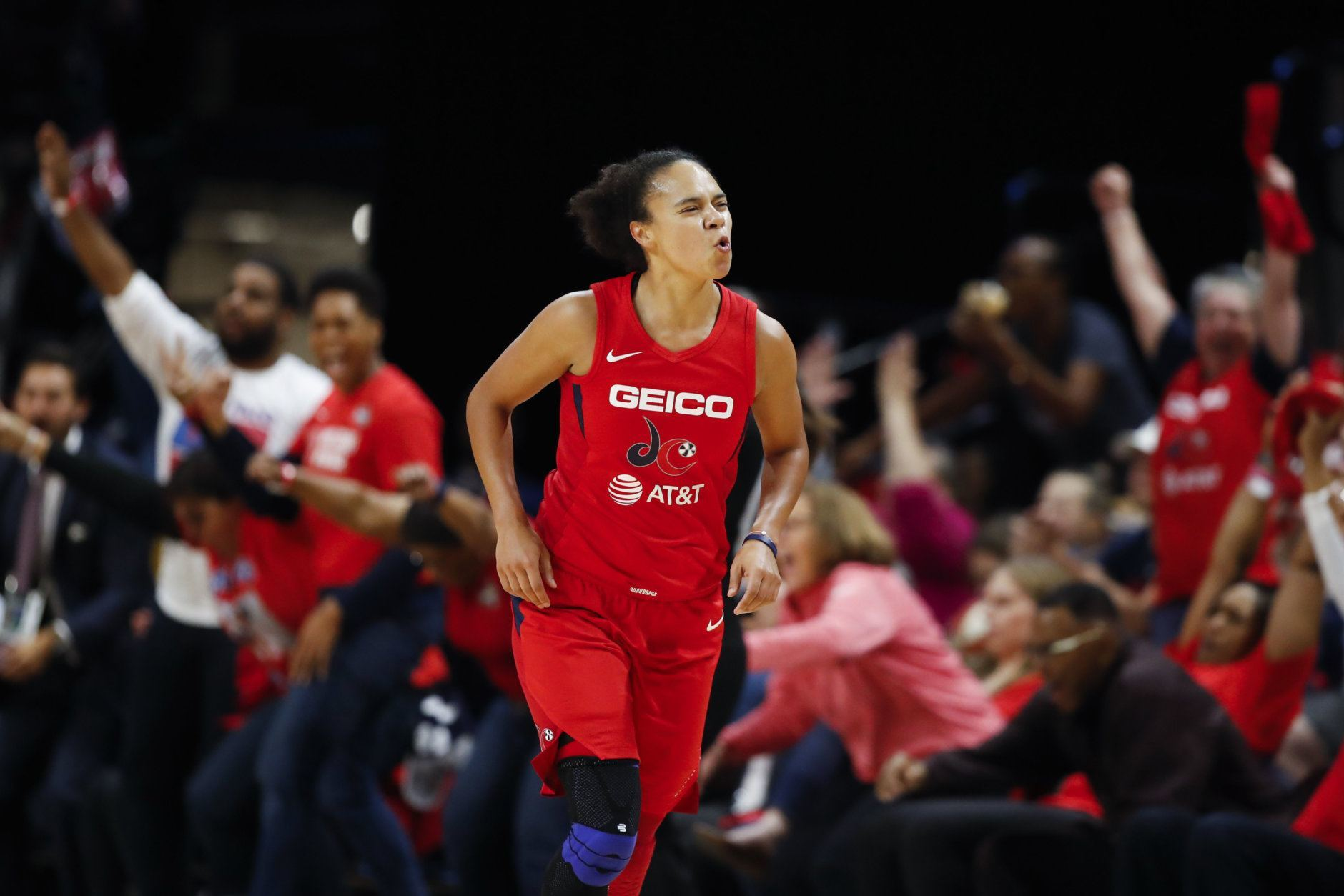Washington Mystics guard Kristi Toliver celebrates after her three-point basket during the first half of Game 5 of basketball's WNBA Finals against the Connecticut Sun, Thursday, Oct. 10, 2019, in Washington. (AP Photo/Alex Brandon)