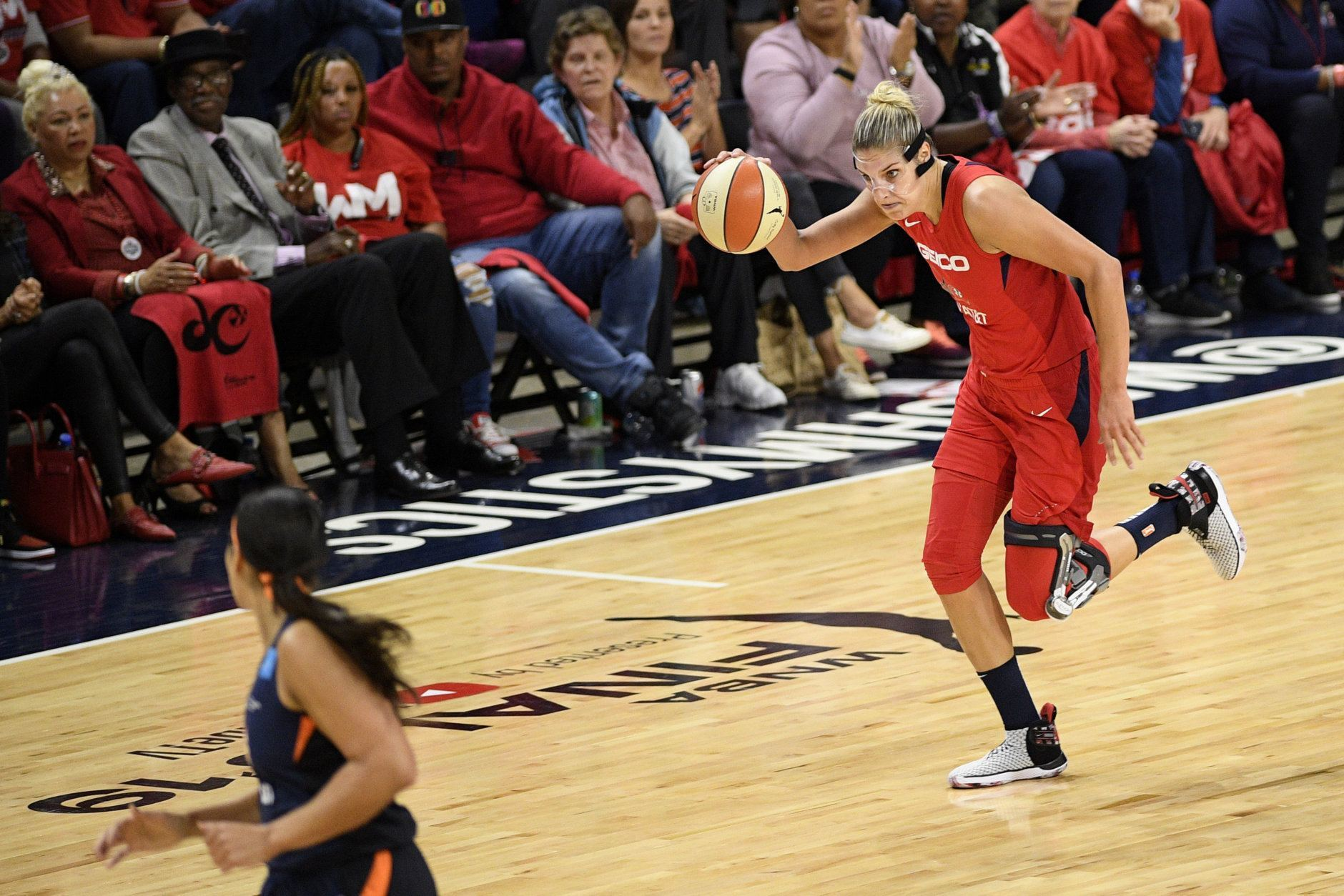 Washington Mystics forward Elena Delle Donne dribbles the ball in the first half of Game 5 of basketball's WNBA Finals against the Connecticut Sun, Thursday, Oct. 10, 2019, in Washington. (AP Photo/Nick Wass)