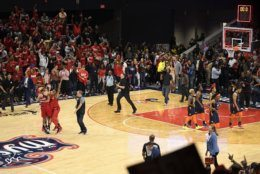 The Washington Mystics, left, celebrates as time runs out in Game 5 of basketball's WNBA Finals against the Connecticut Sun, Thursday, Oct. 10, 2019, in Washington. (AP Photo/Nick Wass)