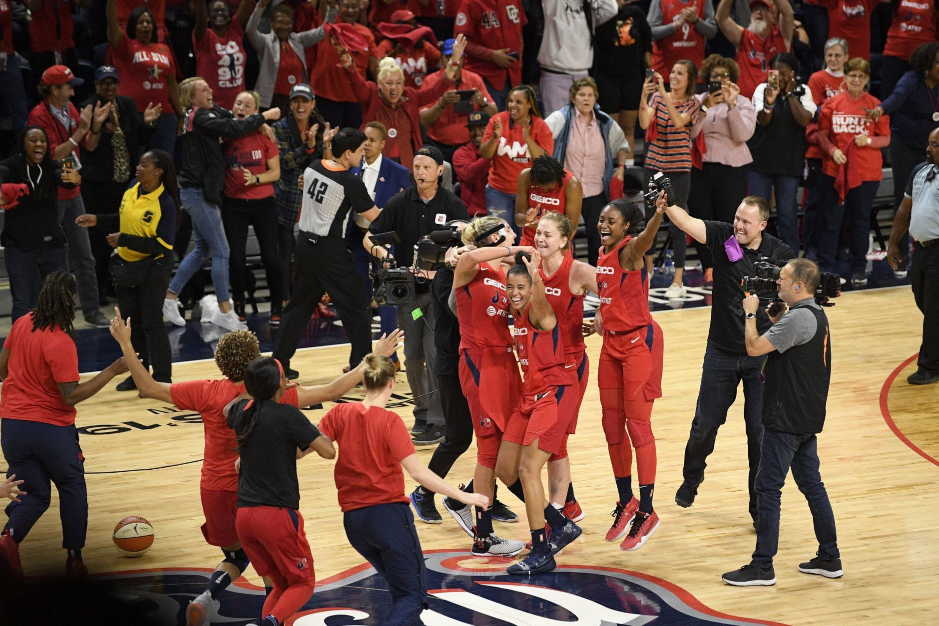 The Washington Mystics celebrate after they beat the Connecticut Sun in Game 5 of basketball's WNBA Finals, Thursday, Oct. 10, 2019, in Washington. (AP Photo/Nick Wass)