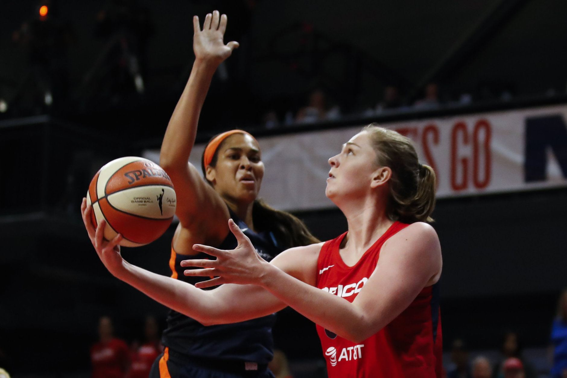 Washington Mystics center Emma Meesseman, right, shoots in front of Connecticut Sun center Brionna Jones during the second half of Game 5 of basketball's WNBA Finals, Thursday, Oct. 10, 2019, in Washington. (AP Photo/Alex Brandon)