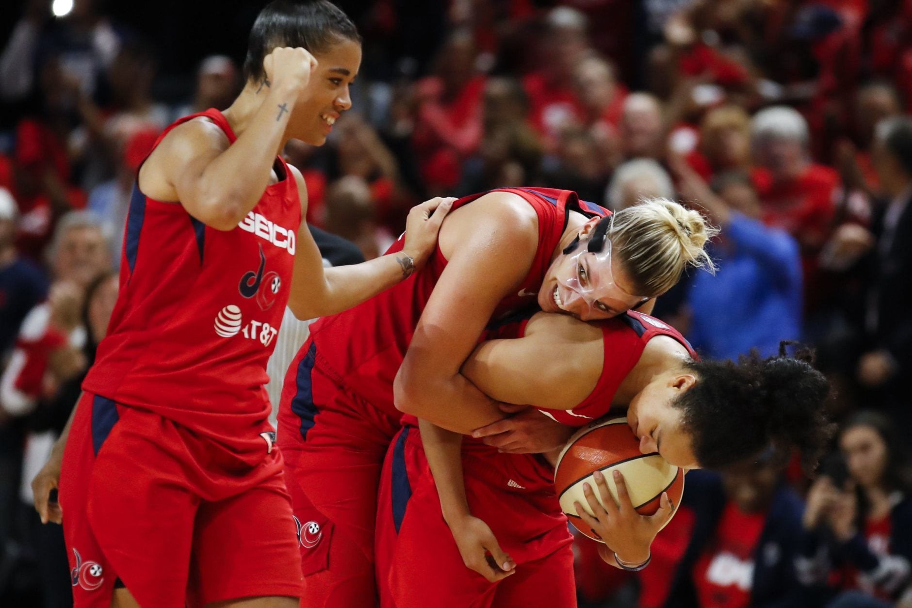 Washington Mystics guard Natasha Cloud, left, forward Elena Delle Donne and guard Kristi Toliver celebrate during the second half of Game 5 of basketball's WNBA Finals, Thursday, Oct. 10, 2019, in Washington.  (AP Photo/Alex Brandon)