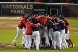 Washington Nationals players celebrate after Game 4 of the baseball National League Championship Series Tuesday, Oct. 15, 2019, in Washington. The Nationals won 7-4 to win the series 4-0. (AP Photo/Alex Brandon)