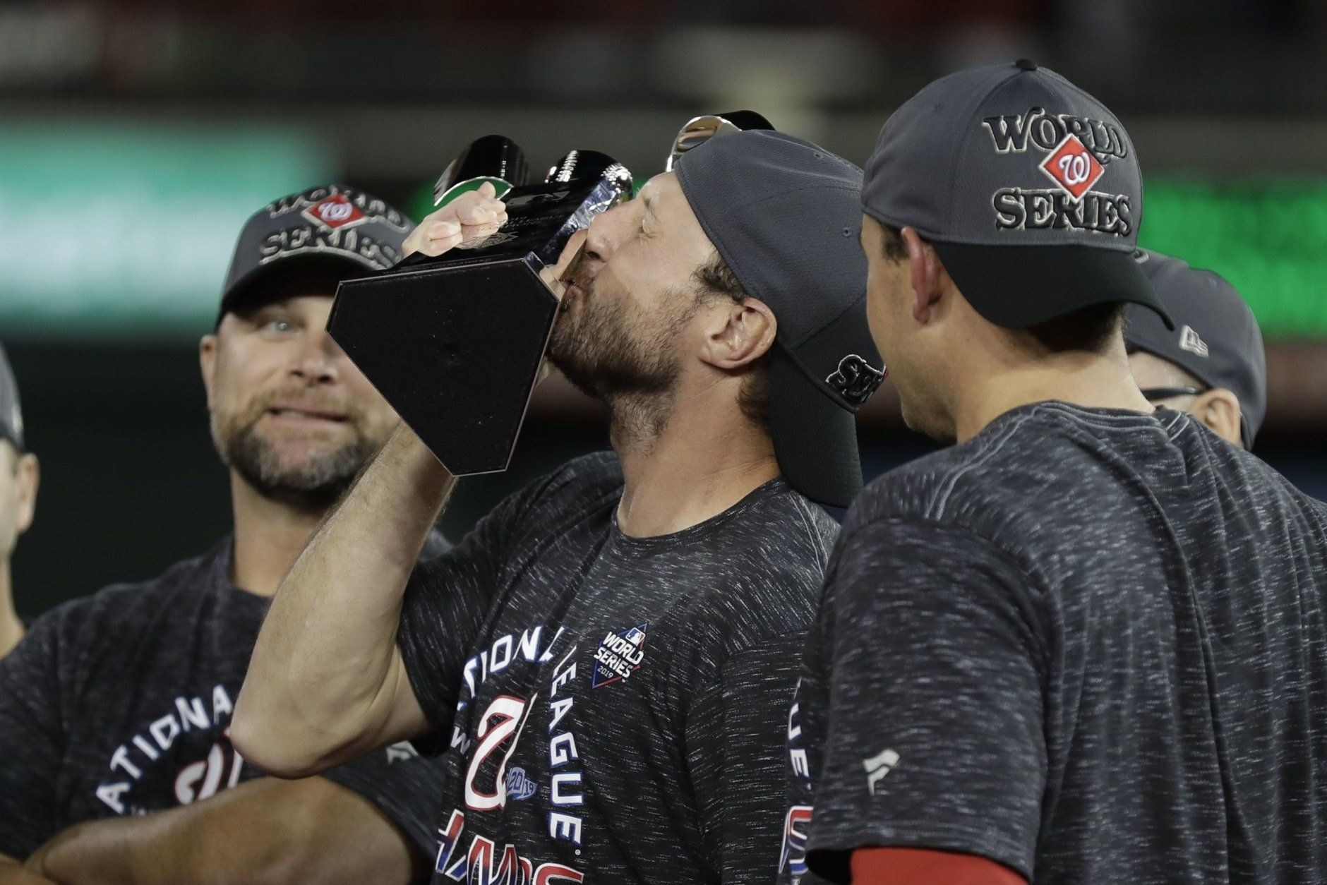 Washington Nationals' Max Scherzer kisses the NLCS trophy after Game 4 of the baseball National League Championship Series against the St. Louis Cardinals Tuesday, Oct. 15, 2019, in Washington. The Nationals won 7-4 to win the series 4-0. (AP Photo/Jeff Roberson)
