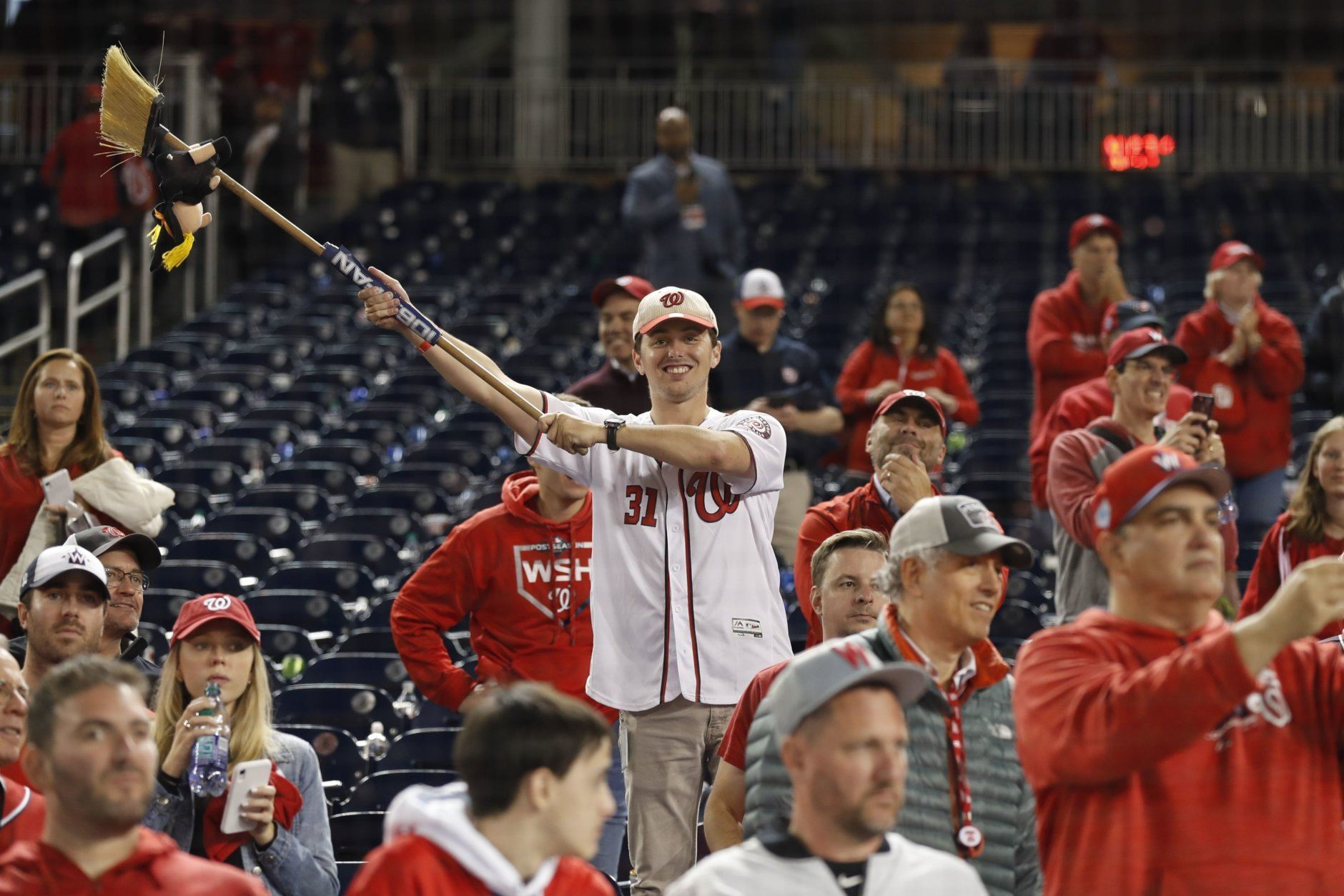 Washington Nationals fans celebrate after Game 4 of the baseball National League Championship Series against the St. Louis Cardinals Tuesday, Oct. 15, 2019, in Washington. The Nationals won 7-4 to win the series 4-0. (AP Photo/Jeff Roberson)