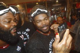 Washington Nationals' Howie Kendrick celebrates after Game 4 of the baseball National League Championship Series against the St. Louis Cardinals Wednesday, Oct. 16, 2019, in Washington. The Nationals won 7-4 to win the series 4-0. (AP Photo/Patrick Semansky)