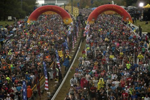 Runners brave strong winds, stormy conditions for Marine Corps Marathon