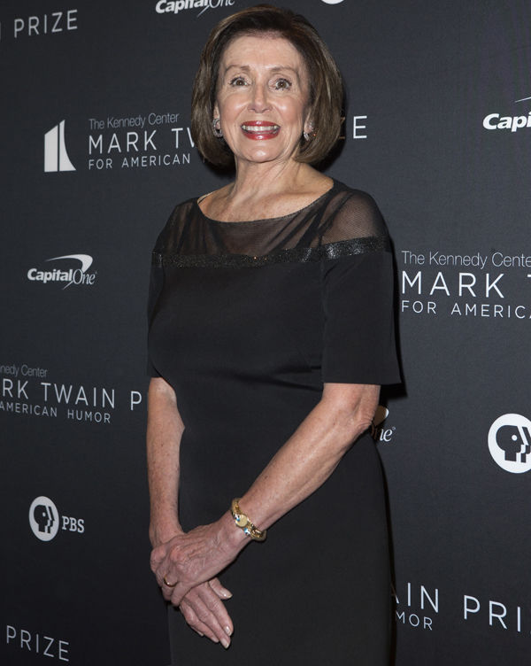 Nancy Pelosi arrives at the Kennedy Center for the Performing Arts for the 22nd Annual Mark Twain Prize for American Humor presented to Dave Chappelle on Sunday, Oct. 27, 2019, in Washington. (Photo by Owen Sweeney/Invision/AP)