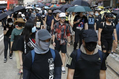 Australian parliamentarian marches with Hong Kong protesters