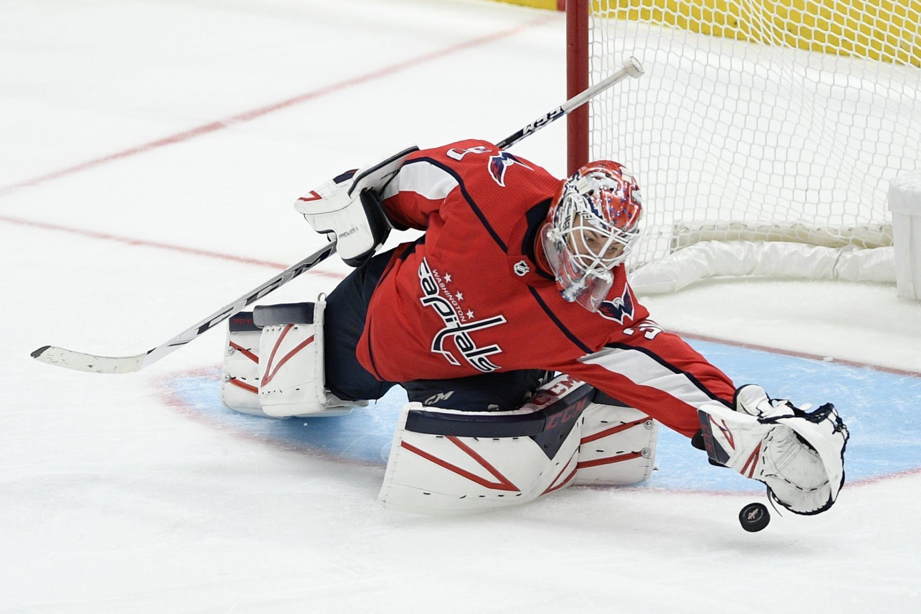 Washington Capitals goaltender Ilya Samsonov (30), of Russia, reaches for the puck during the third period of an NHL hockey game against the Colorado Avalanche, Monday, Oct. 14, 2019, in Washington. (AP Photo/Nick Wass)