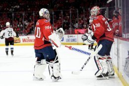 Washington Capitals goaltender Braden Holtby (70) skates off the ice as he is replaced by goaltender Ilya Samsonov (30), of Russia, during the first period of an NHL hockey game against the Colorado Avalanche, Monday, Oct. 14, 2019, in Washington. (AP Photo/Nick Wass)