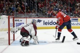 Washington Capitals center Lars Eller (20), of Denmark, scores a goal against Colorado Avalanche goaltender Philipp Grubauer (31), of Germany, during the second period of an NHL hockey game, Monday, Oct. 14, 2019, in Washington. (AP Photo/Nick Wass)