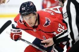 Washington Capitals center Evgeny Kuznetsov (92), of Russia, awaits a face-off during the second period of an NHL hockey game against the Colorado Avalanche, Monday, Oct. 14, 2019, in Washington. (AP Photo/Nick Wass)