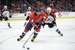 Washington Capitals left wing Alex Ovechkin (8), of Russia, skates with the puck against Colorado Avalanche right wing Joonas Donskoi (72), of Finland, during the second period of an NHL hockey game, Monday, Oct. 14, 2019, in Washington. (AP Photo/Nick Wass)