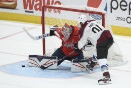 Colorado Avalanche center Nazem Kadri (91) tries to get the puck past Washington Capitals goaltender Ilya Samsonov (30), of Russia, during the third period of an NHL hockey game, Monday, Oct. 14, 2019, in Washington. (AP Photo/Nick Wass)