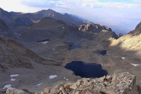 APNewsBreak: Skeleton unearthed beneath California peak