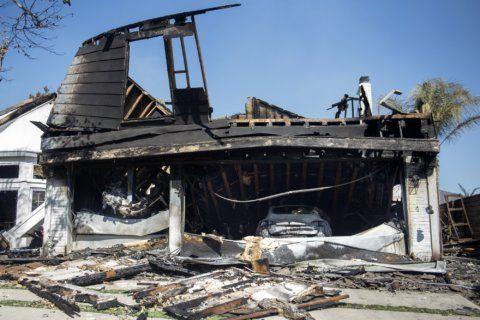 The Latest: Fire department: LA blaze began under power line