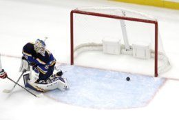 St. Louis Blues goaltender Jordan Binnington watches the game-winning goal by Washington Capitals' Jakub Vrana, of the Czech Republic, during the overtime of an NHL hockey game, Wednesday, Oct. 2, 2019, in St. Louis. The Capitals won 3-2. (AP Photo/Jeff Roberson)