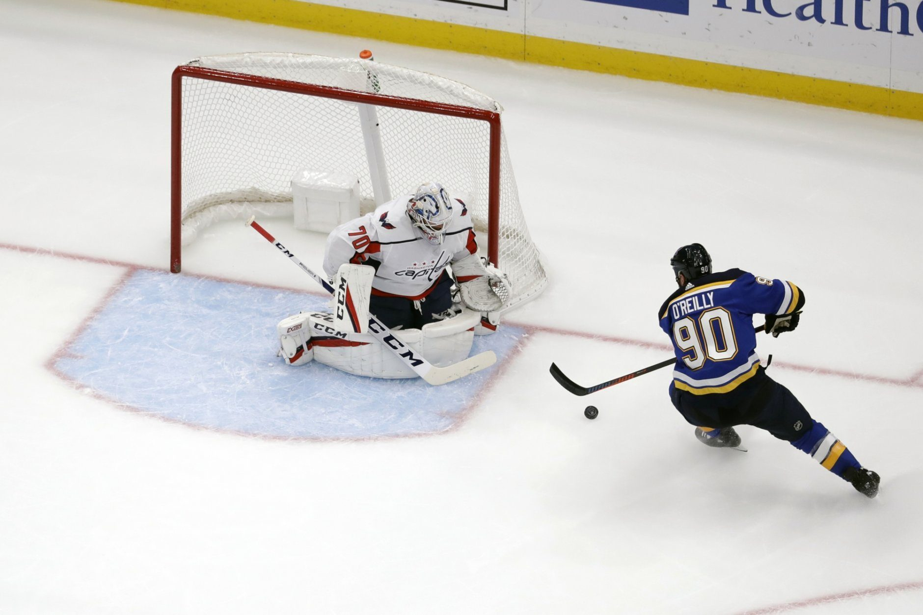 St. Louis Blues' Ryan O'Reilly (90) is unable to get a shot off as Washington Capitals goaltender Braden Holtby (70) defends during the second period of an NHL hockey game Wednesday, Oct. 2, 2019, in St. Louis. (AP Photo/Jeff Roberson)