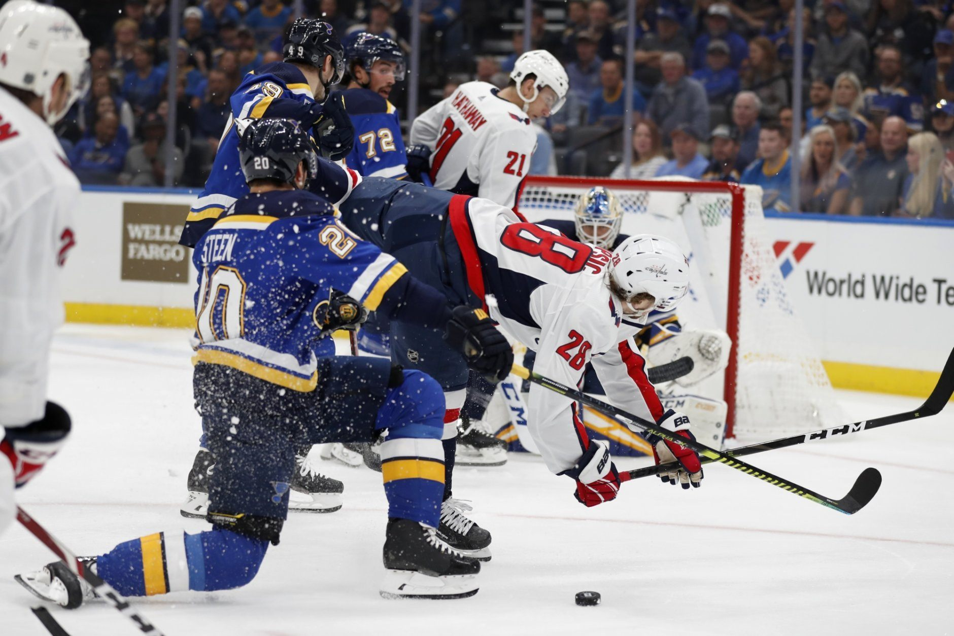 Washington Capitals' Brendan Leipsic (28) is upended while chasing after a loose puck and colliding with St. Louis Blues' Alexander Steen (20) during the first period of an NHL hockey game Wednesday, Oct. 2, 2019, in St. Louis. (AP Photo/Jeff Roberson)