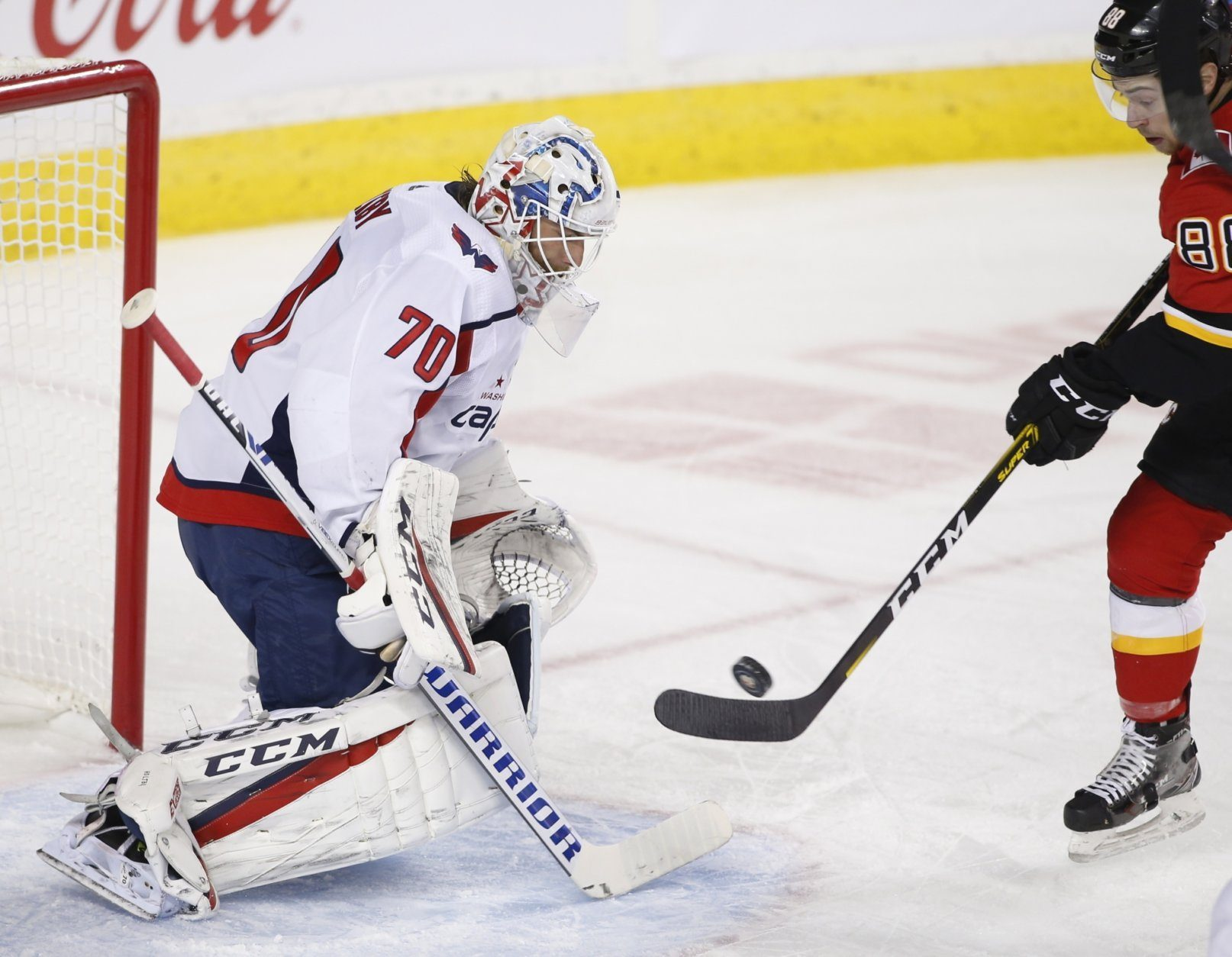 Washington Capitals goalie Brayden Holtby makes a save against Calgary Flames' Andrew Mangiapane during the first period of an NHL hockey game Tuesday, Oct. 22, 2019, in Calgary, Alberta. (Larry MacDougal/The Canadian Press via AP)