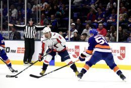 Washington Capitals left wing Alex Ovechkin (8) is defended by New York Islanders defenseman Johnny Boychuk (55), during the first period of an NHL hockey game, Friday, Oct. 4, 2019, in Uniondale, N.Y. (AP Photo/Steven Ryan)