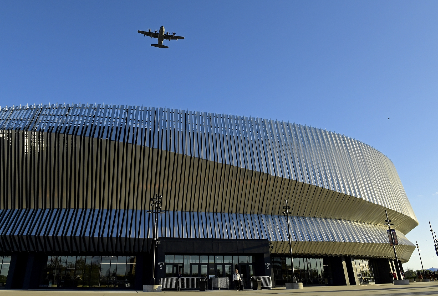 A military aircraft, based out of the Westhampton Beach 106th Rescue Wing, flies over Nassau Coliseum prior to an NHL hockey game between the New York Islanders and the Washington Capitals, Friday, Oct. 4, 2019, in Uniondale, N.Y. (AP Photo/Steven Ryan)