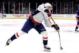 Washington Capitals left wing Jakub Vrana (13) scores a goal against the New York Islanders during the first period of an NHL hockey game, Friday, Oct. 4, 2019, in Uniondale, N.Y. (AP Photo/Steven Ryan)