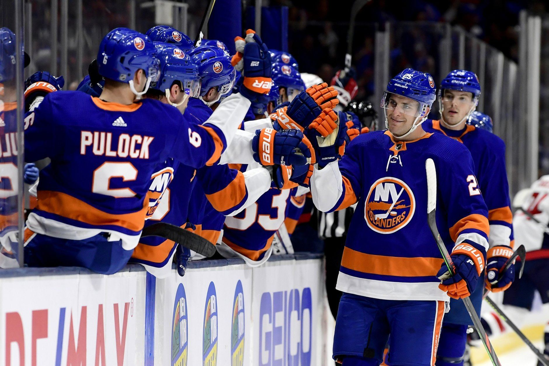 New York Islanders defenseman Devon Toews (25) is congratulated by his teammates after scoring a goal, against the Washington Capitals during the first period of an NHL hockey game, Friday, Oct. 4, 2019, in Uniondale, N.Y. (AP Photo/Steven Ryan)