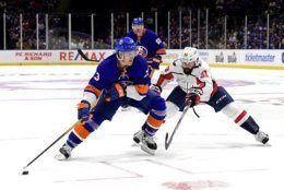 New York Islanders center Mathew Barzal (13) is defended by Washington Capitals defenseman Radko Gudas (33) during the second period of an NHL hockey game, Friday, Oct. 4, 2019, in Uniondale, N.Y. (AP Photo/Steven Ryan)