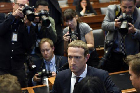 The Latest: Congressman compares Facebook CEO to president