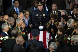 Members of the Congressional Black Caucus gather around the casket during a memorial service for Rep. Elijah Cummings, D-Md., at the U.S. Capitol in Washington, Thursday, Oct. 24, 2019. The Maryland congressman and civil rights champion died Thursday, Oct. 17, at age 68 of complications from long-standing health issues. (Al Drago/Pool via AP)