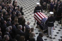 The flag-draped casket of Rep. Elijah Cummings, D-Md., is carried through the Capitol, where he will lie in state, Thursday, Oct. 24, 2019 in Washington. (Alex Wong/Pool via AP)