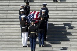 The flag-draped casket of Rep. Elijah Cummings, D-Md., is carried by a joint services military honor guard up the steps of the U.S. Capitol, in Washington, Thursday, Oct. 24, 2019. The Maryland congressman and civil rights champion died Thursday, Oct. 17, at age 68 of complications from long-standing health issues. (AP Photo/Jose Luis Magana)