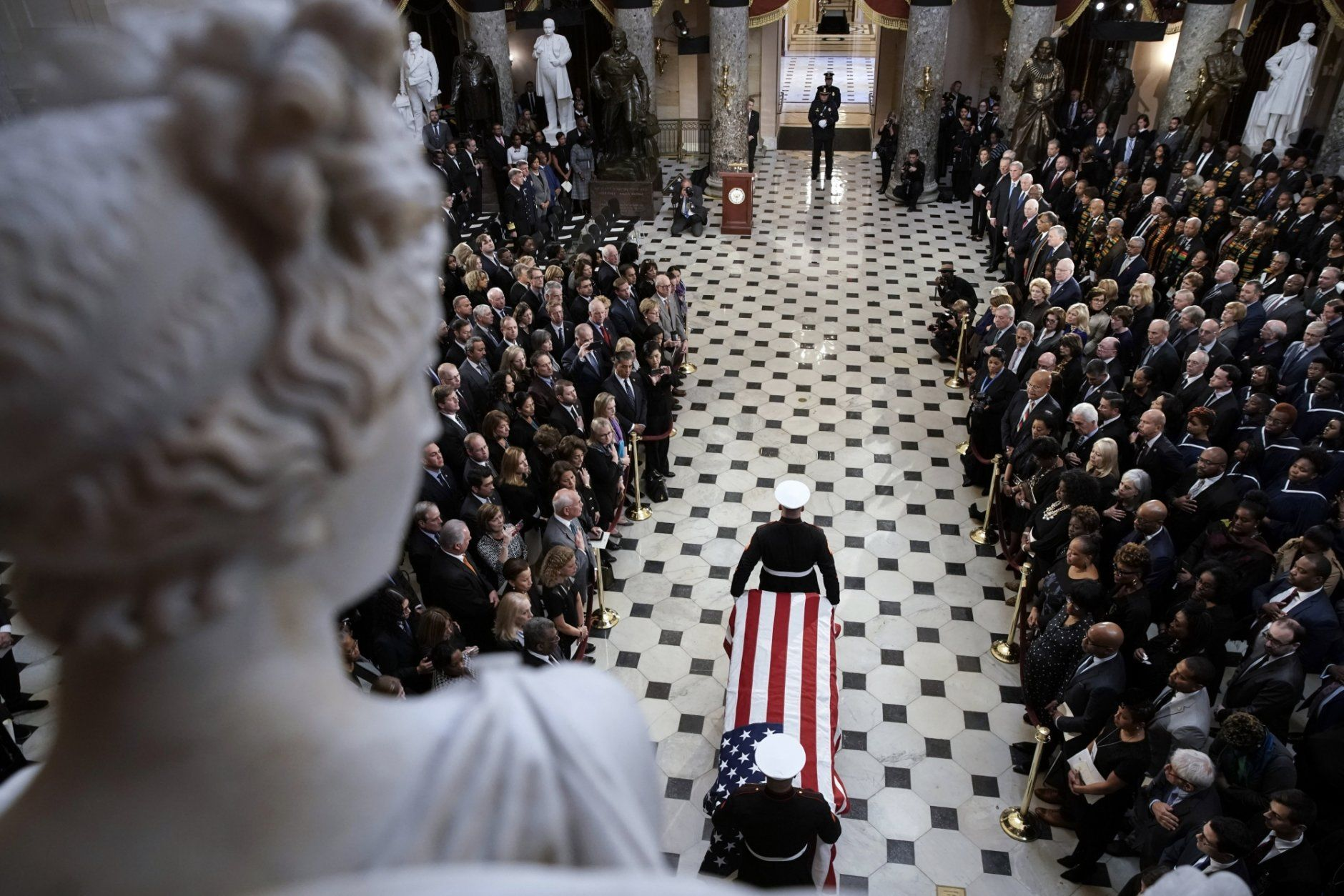 A military honor guard moves the casket Rep. Elijah Cummings, D-Md., into Statuary Hall at the U.S. Capitol in Washington, Thursday, Oct. 24, 2019, for a memorial service. The Maryland congressman and civil rights champion died Thursday, Oct. 17, at age 68 of complications from long-standing health issues. (Al Drago/Pool via AP)