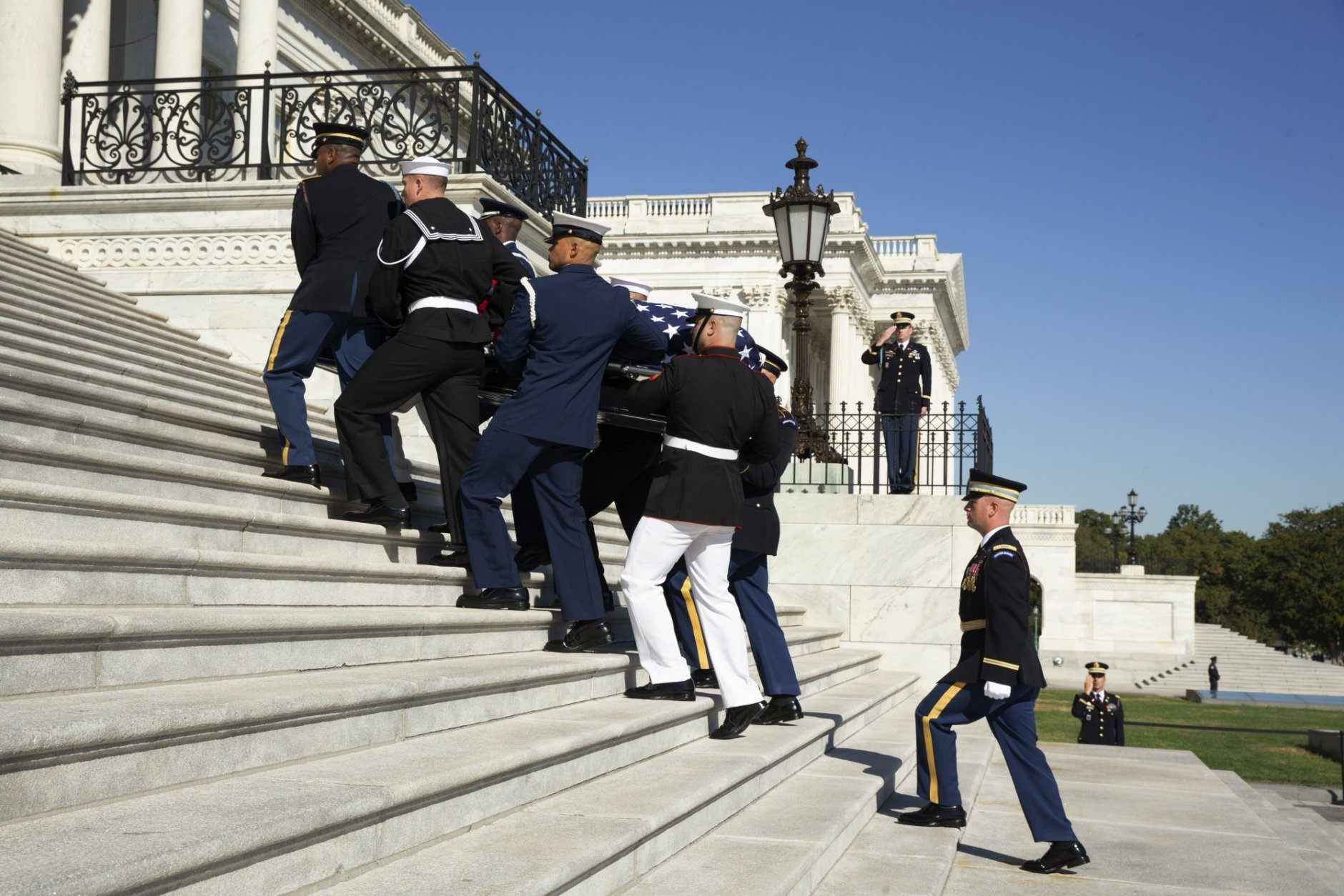 The casket of Rep. Elijah Cummings is carried by a military carry team up the East Front stairs into the U.S. Capitol Thursday, Oct. 24, 2019, in Washington. The Maryland congressman and civil rights champion died Thursday, Oct. 17, at age 68 of complications from long-standing health issues. (Michael Reynolds/Pool via AP)