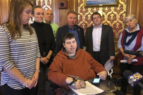 In Wisconsin, vote to aid disabled lawmaker turns partisan
