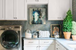 This undated photo provided by interior designer Brian Patrick Flynn shows a laundry room designed by Flynn. Flynn advises homeowners to have fun with color and patterns as they decorate a laundry room, adding art and other objects to make the space more personalized and appealing. (Robert Peterson/Rustic White Photography/Brian Patrick Flynn via AP)