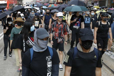 The Latest: Hong Kong lawmakers seek to block mask ban