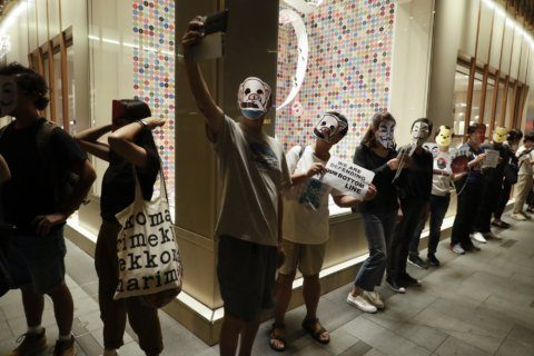 Hong Kong protesters don cartoon masks to defy face mask ban