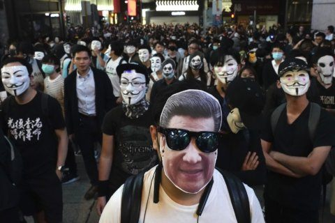 China vows bolstered legal measures over Hong Kong protests